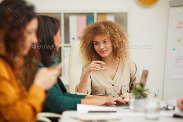 Female Colleagues Chatting During Meeting - Stock Photo - Images