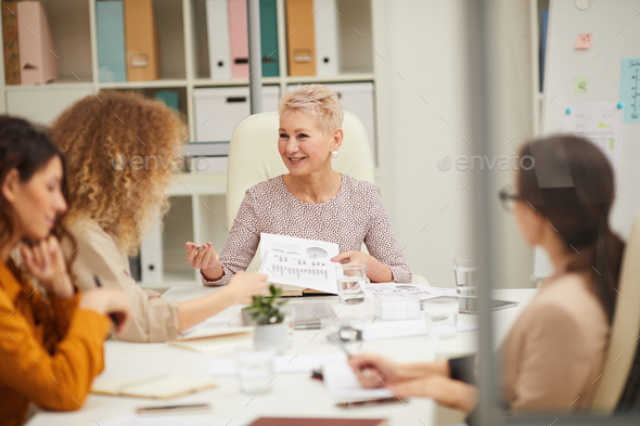 Mature Businesswoman Talking To Staff - Stock Photo - Images