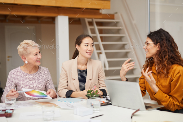 Three Clothes Designers Choosing Colours - Stock Photo - Images