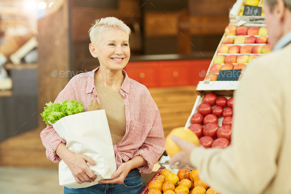 Smiling Adult Woman Buying Vegetables at Farmers Market - Stock Photo - Images