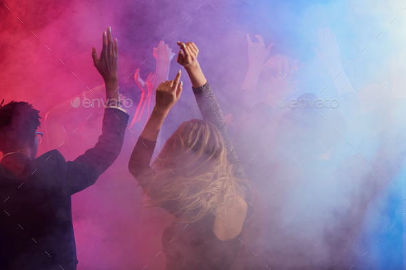 Dancing Crowd in Smoky Nightclub - Stock Photo - Images