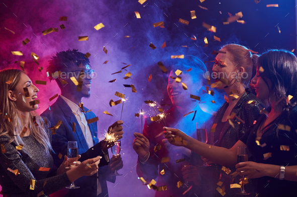 People Lighting Sparklers at Nightclub - Stock Photo - Images
