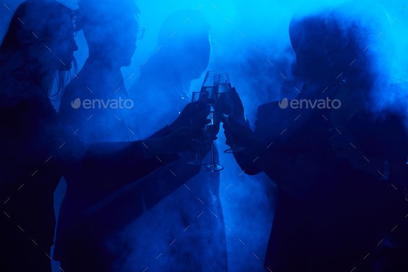 Crowd Dancing in Smoky Nightclub - Stock Photo - Images