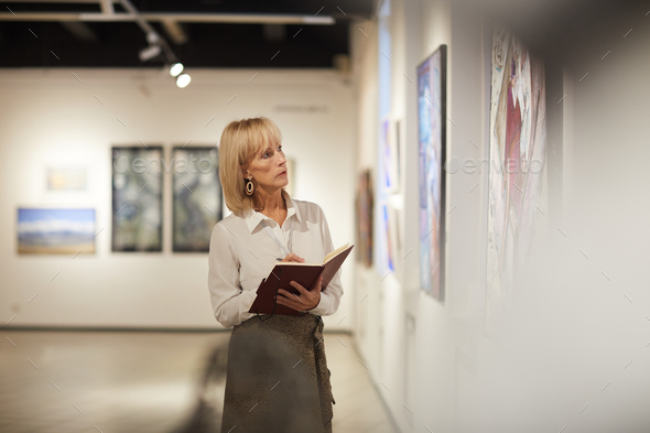 Mature Art Gallery Manager - Stock Photo - Images