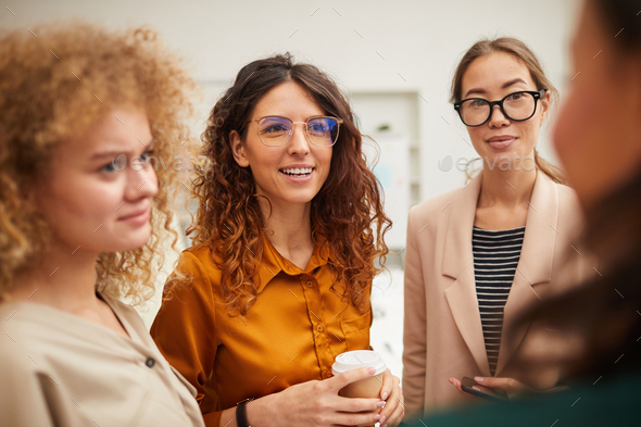 Colleagues Chatting During Break - Stock Photo - Images