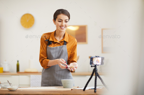 Young Woman Filming Baking Video in Kitchen - Stock Photo - Images