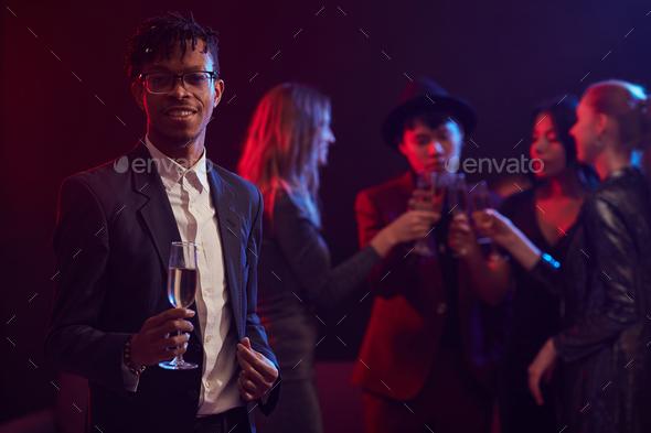 Elegant African Man Posing in Nightclub - Stock Photo - Images