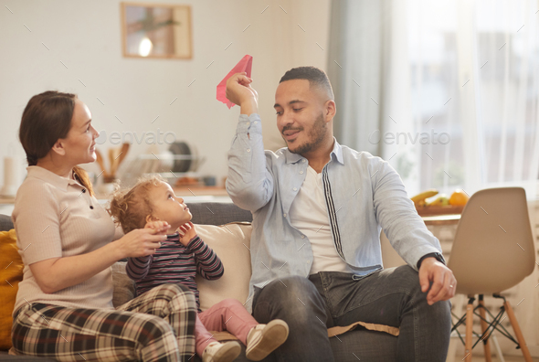 Modern Family Playing with Little Girl at Home - Stock Photo - Images