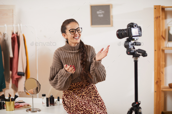 Smiling Young Woman Talking to Camera in Beauty Studio - Stock Photo - Images