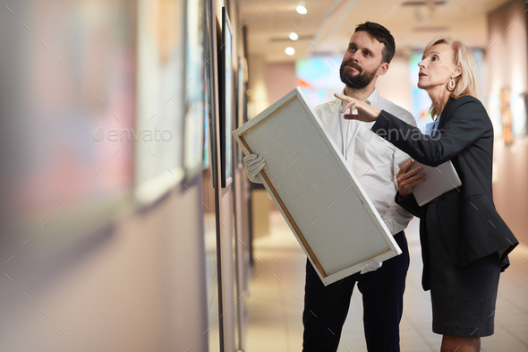 Businesswoman Buying Painting in Art Gallery - Stock Photo - Images