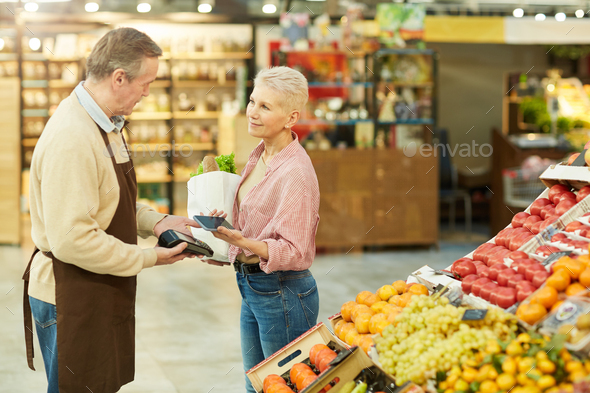 Paying via NFC at Farmers Market - Stock Photo - Images