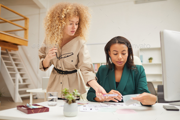 Two Ethnically Diverse Colleagues Coworking - Stock Photo - Images