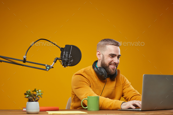 Vlogger Working On Laptop - Stock Photo - Images