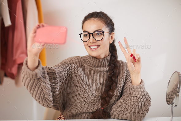 Young Woman Taking Selfie at Home - Stock Photo - Images