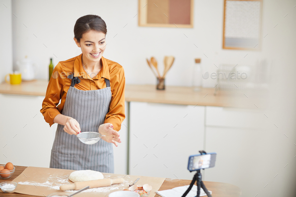 Beautiful Young Woman Filming Baking Video - Stock Photo - Images