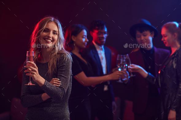 Beautiful Woman Posing in Nightclub - Stock Photo - Images