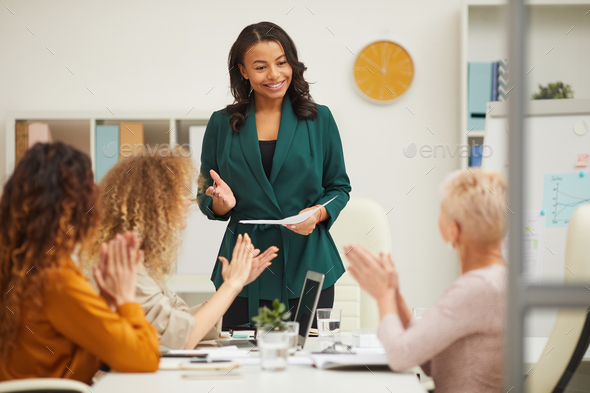 Charming African American Woman Finishing Presentation - Stock Photo - Images