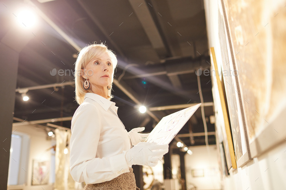 Art Gallery Manager in Museum - Stock Photo - Images
