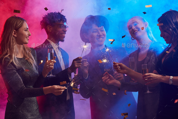 Ethnic Group of People Celebrating in Smoky Nightclub - Stock Photo - Images
