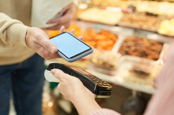 Unrecognizable Customer Paying via NFC at Farmers Market - Stock Photo - Images