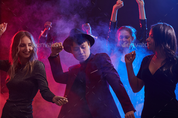 Young People Dancing in Smoky Nightclub - Stock Photo - Images