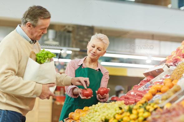 Senior Man Buying Food at Farmers Market - Stock Photo - Images