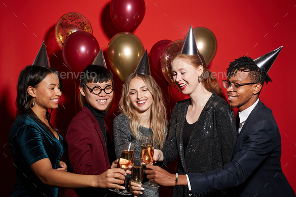 Multi-Ethnic Group of Friends Toasting at Party - Stock Photo - Images