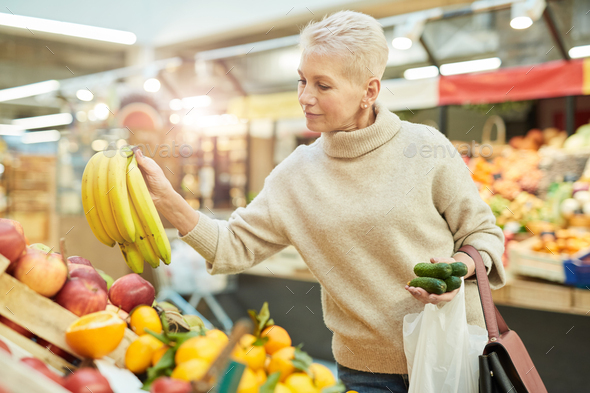Senior Woman Grocery Shopping at Farmers Market - Stock Photo - Images
