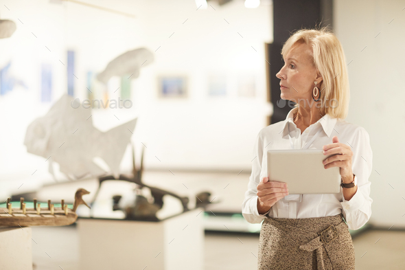 Elegant Woman Managing Art Gallery Exhibition - Stock Photo - Images
