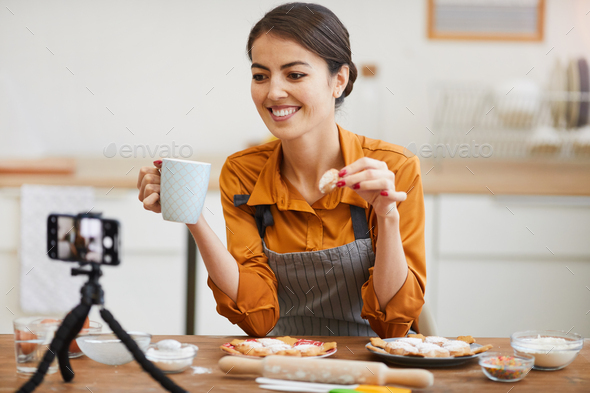 Young Woman Filming in Cozy kitchen - Stock Photo - Images