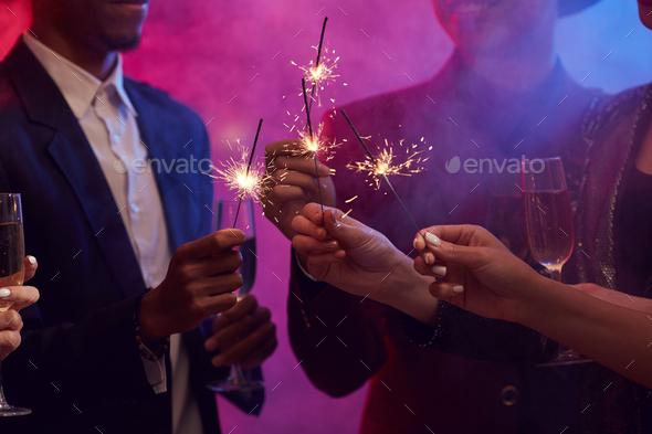 People Lighting Sparklers in Smoky Nightclub - Stock Photo - Images