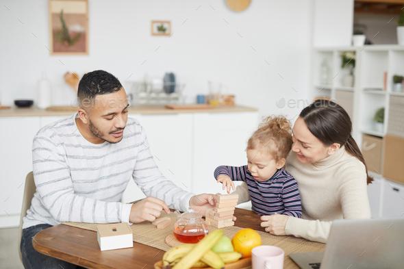 Modern Family Enjoying Breakfast - Stock Photo - Images
