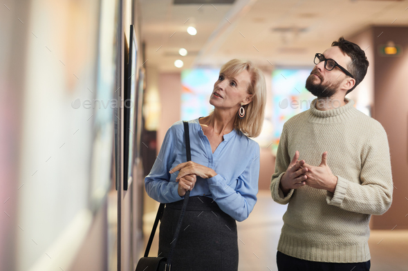 Mature Couple Enjoying Art Exhibition in Museum - Stock Photo - Images