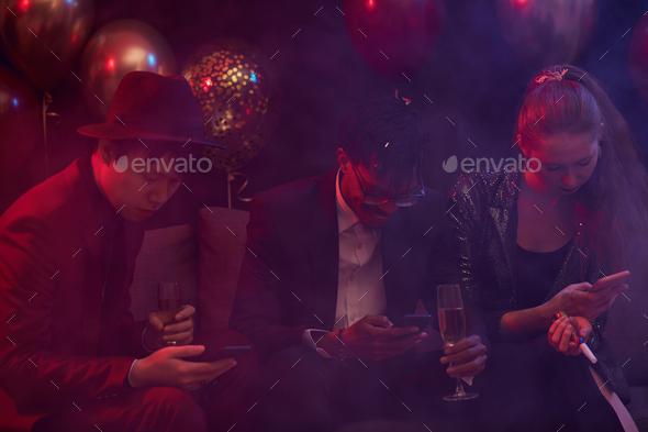 People Using Smartphones in Nightclub - Stock Photo - Images