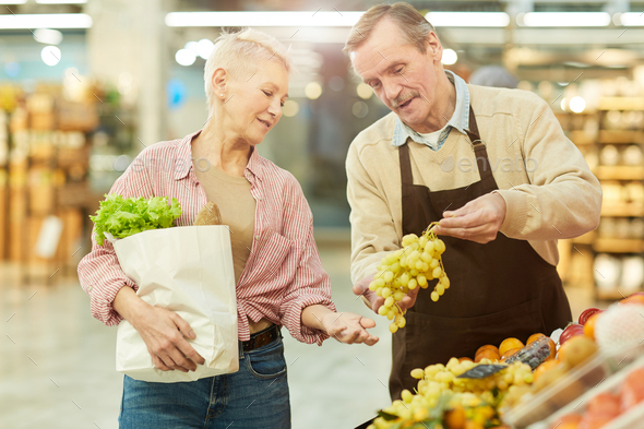 Fruit Shop Owner Helping Customer - Stock Photo - Images