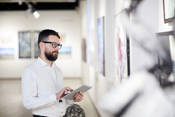 Bearded Man Managing Modern Art Gallery - Stock Photo - Images