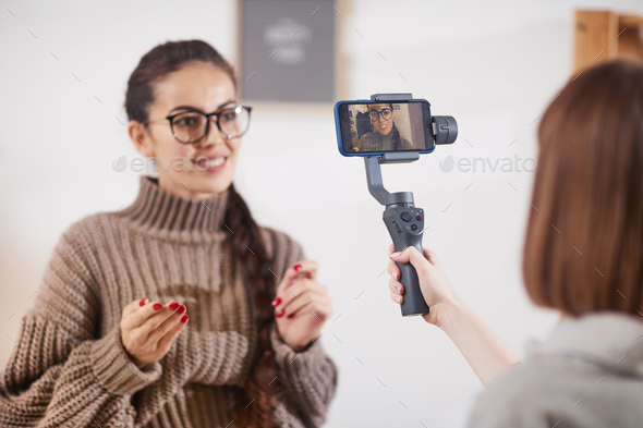 Smiling Woman Filming Video for Social Media Channel - Stock Photo - Images