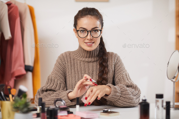 Beauty Blogger Testing Makeup on Camera - Stock Photo - Images