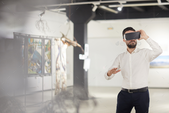 Bearded Man Using VR in Museum - Stock Photo - Images