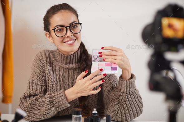Young Woman Filming Make Up Review - Stock Photo - Images
