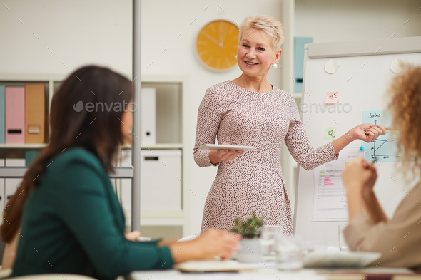 Elelgant Middle-Aged Woman Making Presentation - Stock Photo - Images