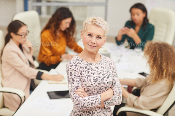Confident Mature Businesswoman With Arms Crossed - Stock Photo - Images