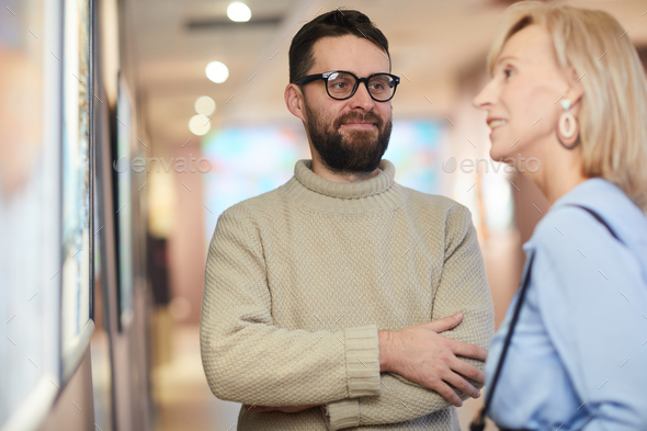 Adult Couple Enjoying Art Exhibition - Stock Photo - Images