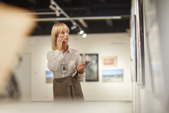 Mature Woman Managing Art Gallery - Stock Photo - Images