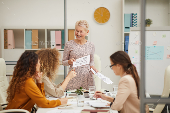 Cheerful Mature Woman Making Business Presentation - Stock Photo - Images