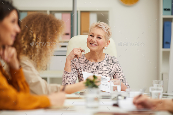 Mature Caucasian Businesswoman At Meeting With Staff - Stock Photo - Images