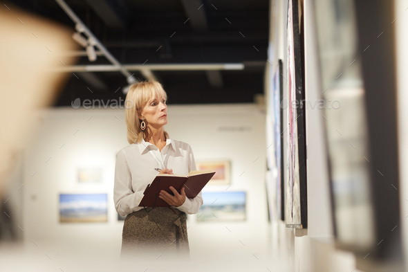 Art Gallery Manager at Work - Stock Photo - Images