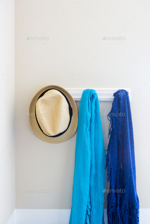 Wall in House with Hat and Scarfs Hanging on Coat Rack Hooks Abstract - Stock Photo - Images