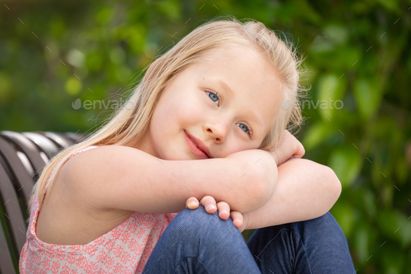 Pretty Young Caucasian Girl Portrait Sitting On The Bench At The Park - Stock Photo - Images