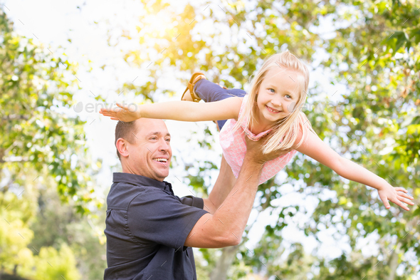 Young Caucasian Father and Daughter Having Fun At The Park - Stock Photo - Images